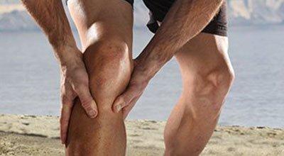 man holding his aching knee